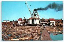 Postcard WI Ashland Pulpwood Heist Logging Industry Log Float Rafted c1950s R52