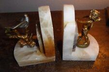 Paire de serre livre bronze albâtre  au putto et colombe signé Ferrand
