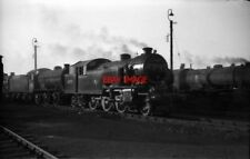 PHOTO  THOMPSON L1 2-6-4T 67737 IN A BUSY SHED YARD AT DONCASTER MPD SUMMER 1959
