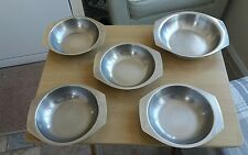 selection of 5 stainless steel serving dishes
