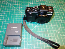 Canon Power Shot G12 camera with charger