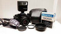 Praktica B100 35mm film SLR camera kit with 50mm lens, flash case and extras