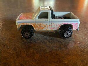 1977 Hot Wheels white/orange/pink splatter paint.  Excellent conditiont truck.