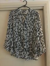 Ladies sheer buttoned shirt size 12 from Jacqui E