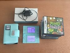 Nintendo DS Lite Bundle With 10 games and a wallet case and a travel case