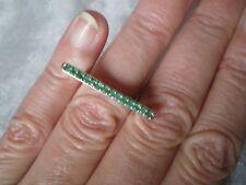 Zambian Emerald bridge ring, size J/K, 0.38 carats, 2.66 grams of 925 Sterling