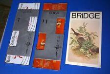 Bridge metal playing card holders, #11 & #7, score pad, Reddy Kilowatt, oriental
