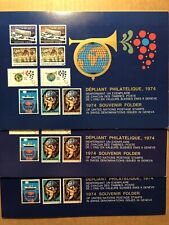 3 DIFFERENT 1974 UNITED NATIONS GENEVA SOUVENIR FOLDERS - 2 HAVE FD CAN. STAMPS