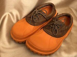 Crocs Unisex Axle adult All-terrain Duck Shoe Leather upper M 8 W 10 orange
