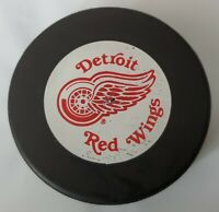 DETROIT RED WINGS NHL VTG GT SLUG OFFICIAL GAME PUCK JOHN A. ZIEGLER TRENCH MFG.