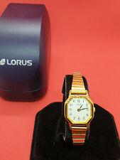 ladies lorus gold tone bracelet dress watch,white face,in its original box.