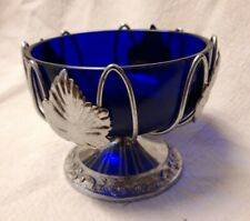 glass dish in metal basket