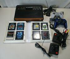 VINTAGE 1980'S ATARI 2600 VIDEO GAME SYSTEM + 8 GAMES 2 CONTROLLERS & MORE VIDEO