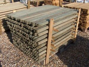 10 4ft tall x 40mm machine round wooden posts stakes with pointed end