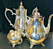 "2 WM Rogers Silver Plate Coffee/Tea Pot  11""tall + 9"" & matching creamer"