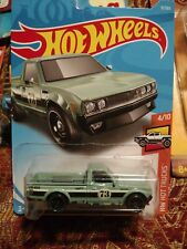 HOT WHEELS Datsun 620 pick up truck  1:64 Scale die cast new on blister