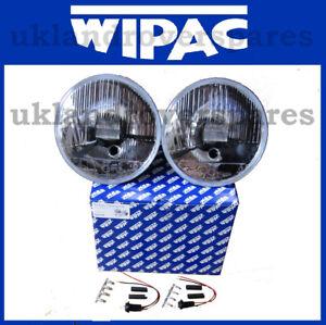 Classic Mini 7 inch Quadoptic Headlamp Kit. Pair Headlights + Pilot + H4 Bulbs