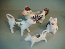 Assorted ceramic cow creamers