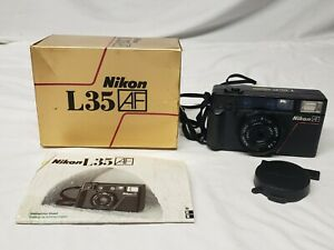 Nikon L35 AF 35mm Camera with box and manual untested nice lens cap