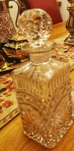 Large heavily patterned cut glass decanter