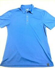 Ogio Mens Blue golf shirt size.Med. 4 buttons