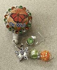 Personalized Orange Butterfly card reel/ id badge holder for nurses, teachers...