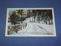 VINTAGE BLOOMINGDALE ROAD IN WINTER SARANAC LAKE   NEW YORK   POSTCARD