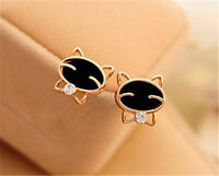 Very cute gold and black cat stud earrings