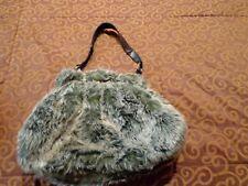 Bolsa de pelo gris. Con bolsa. Ideal regalo. Mira mis otros artículos.