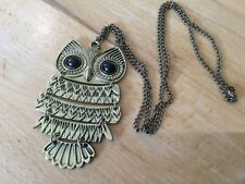 Large articulated owl pendant on long brass coloured chain