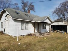 2 bed 1 ba single family home, double lot w/shed, no back taxes, huge potential!