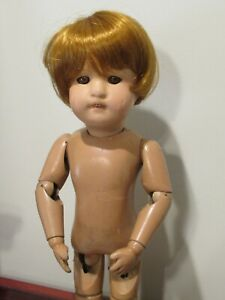 """Schoenhut Miss Dolly 14"""" tall. Red wig Sleep Eyes Joints work well.Label on back"""