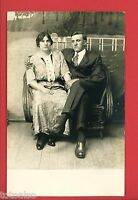 RPPC UNHAPPY MAN WOMAN  COUPLE SITTING IN RATTAN CHAIR   REAL PHOTO  POSTCARD