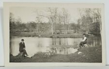 RPPC Two Men in Suits Seated at Lake for Photo Rustic Scene c1910  Postcard P14