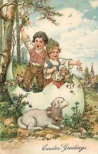 EASTER GREETINGS - PFB 8684 - CHILDREN IN LARGE EGG LAMB EMBOSSED OLD POSTCARD