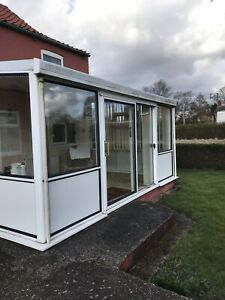 Lean To Conservatory White Upvc. Polycarbonate Roof Inc Blinds And Extractor Fan
