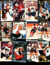 ERIC LINDROS LOT OF 54 ALL DIFFERENT HOCKEY CARDS FLYERS RANGERS
