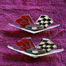 63 64 1965 1966 NOS CORVETTE FENDER CROSS FLAG EMBLEM PAIR GM OEM NEW