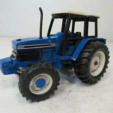 Ford 6640 with  MFWD and  Wide Rear Tires  - by Ertl- 1/16th Scale