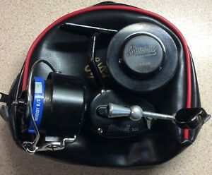 Vintage MITCHELL 300 fishing reel with spare spool and reel bag