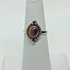 A242 SS Ring w/tigers eye style stone in a ring size 6.