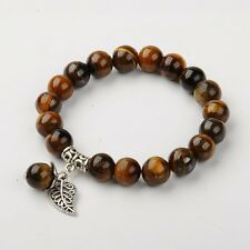 Bracelet, style tibétain en perles d'oeil de tigre, 1 rang,  extensible.