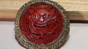 ANTIQUE CHINESE RED CINNABAR DRAGON BROOCH/PENDANT ORNAMENTAL BRASS BORDER TRIM