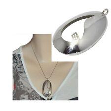 Gros pendentif vintage argenté de style moderniste bijou