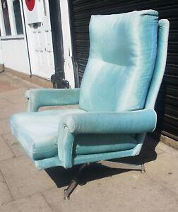 Vintage 1970s chrome based Howard Keith upholstered swivel armchair