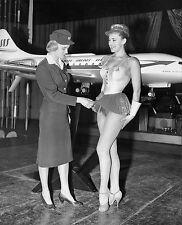 1959  Swedish stewardess showing off sexy new hostess ataire  8 x 10 Photograph