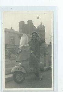 Real photo postcard of a Scooter  lady rider in good condition Reg PUF 370
