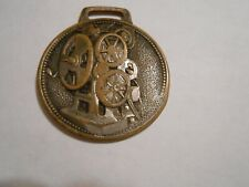 1900's Powers Cameragraph watch fob motion picture machine