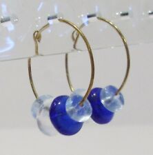 handmade gold hoop earrings with clear and blue glass beads