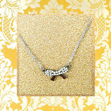 """CC20110 - """"silver"""" pendant with shimmering bow stainless steel pendent"""